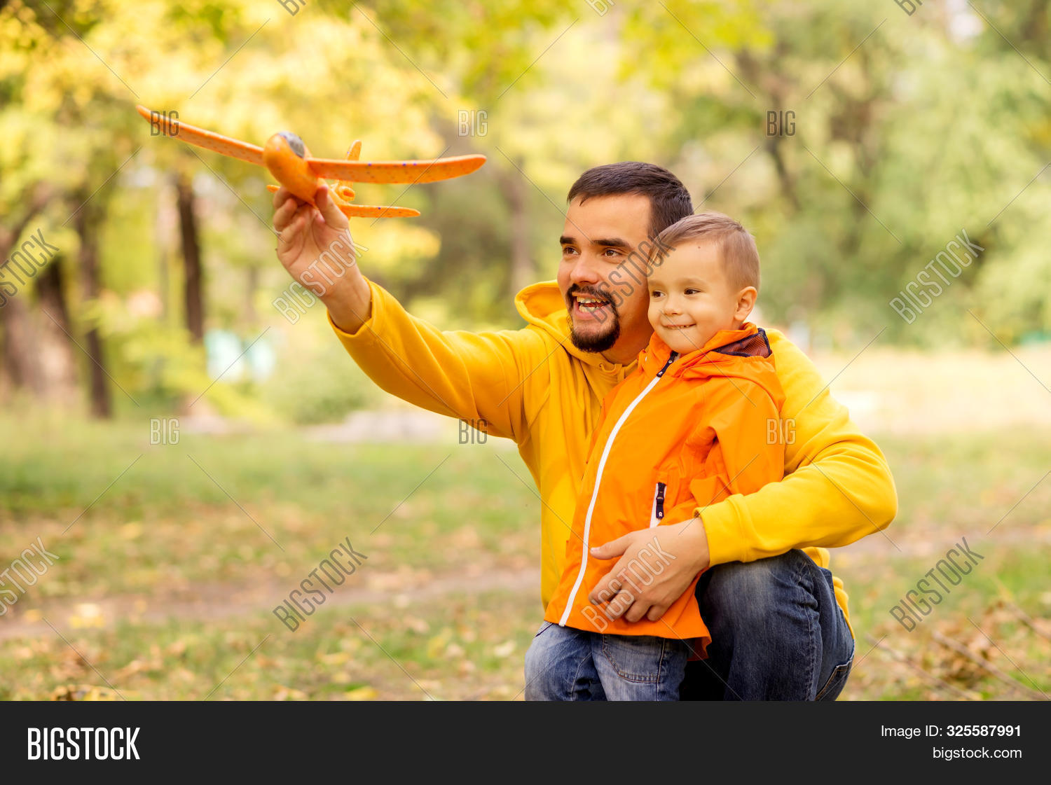 active,aircraft,airplane,asian,autumn,background,boy,caucasian,child,childhood,dad,daddy,embrace,family,father,fly,forest,fun,game,golden,good,happiness,happy,having,holding,joy,kid,latino,launch,leisure,little,middle-aged,orange,outdoors,parenting,park,plane,play,smile,son,spending,time,toddler,together,toy,travel,trees,vacation,yellow,young