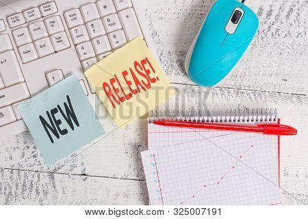 Handwriting text writing New Release. Concept meaning announcing something newsworthy recent product Writing equipments and computer stuffs placed above classic wooden table. stock photo