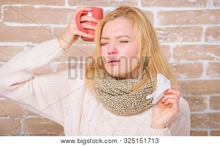 Girl hold tea mug and tissue. Runny nose and other symptoms of cold. Drinking plenty fluid important for ensuring speedy recovery from cold. Drink more liquid get rid of cold. Cold and flu remedies stock photo