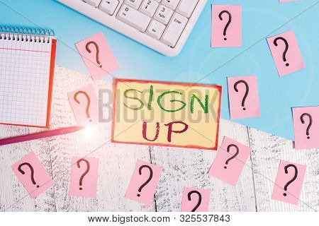 Text sign showing Sign Up. Conceptual photo use your information to register in website team college or blog Writing tools, computer stuff and math book sheet on top of wooden table. stock photo