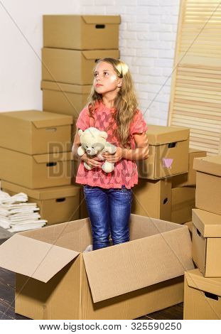 Relax. Moving concept. new apartment. purchase of new habitation. Cardboard boxes - moving to new house. happy child cardboard box. happy little girl with toy stock photo