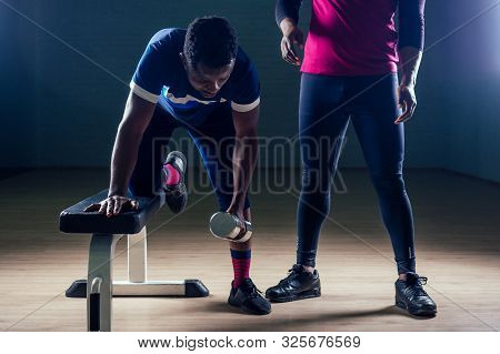 team work two handsome african american sportsman in boxing on a black background in the gym, trainer and ward practicing boxing stock photo