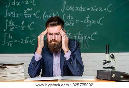 Terrible headache. Teacher has headache. Bearded man suffer from headache. Headache and migraine. Health problem stock photo