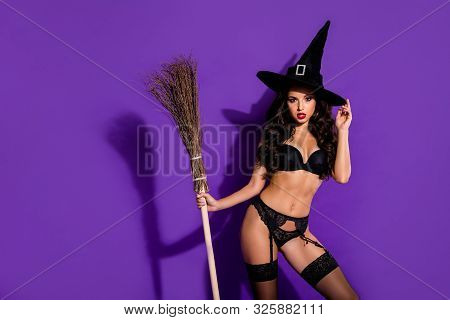 Portrait of her she nice-looking attractive charming sporty alluring gorgeous wavy-haired girl posing with broom isolated on bright vivid shine vibrant violet purple lilac color background stock photo