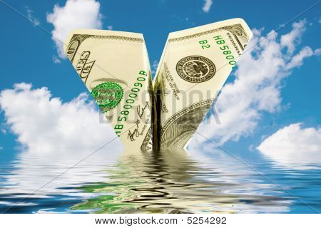 bankruptcy business. money plane crash in water stock photo