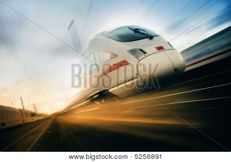 hight speed fast moving train on a blurred backgroung stock photo