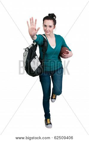 beautiful young woman student playing a game of football running with the ball stock photo