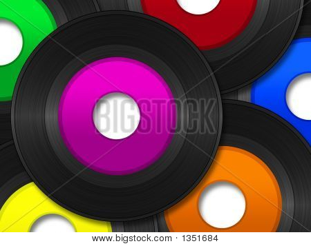a pile of 45 rpm vinyl records with multi colored labels. stock photo
