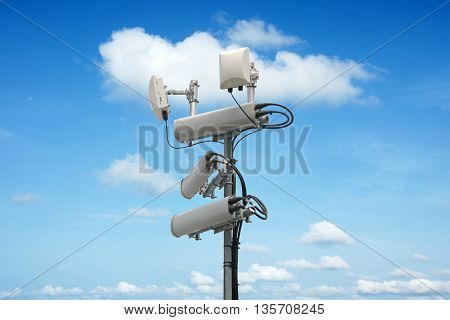 Cellular network antenna with wifi hotspot repeater and blue sky. stock photo