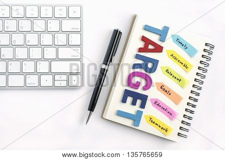 Alphabet letters words target with handwriting timely achievable relevant goals education teamwork on the notebook with pen and keyboard isolated on white background, business success concept stock photo