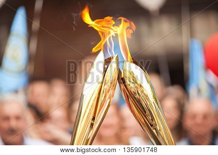 Sports relay. Sports torch relay. Sport symbol. Symbol of sports fulfillments. Fire transfer.