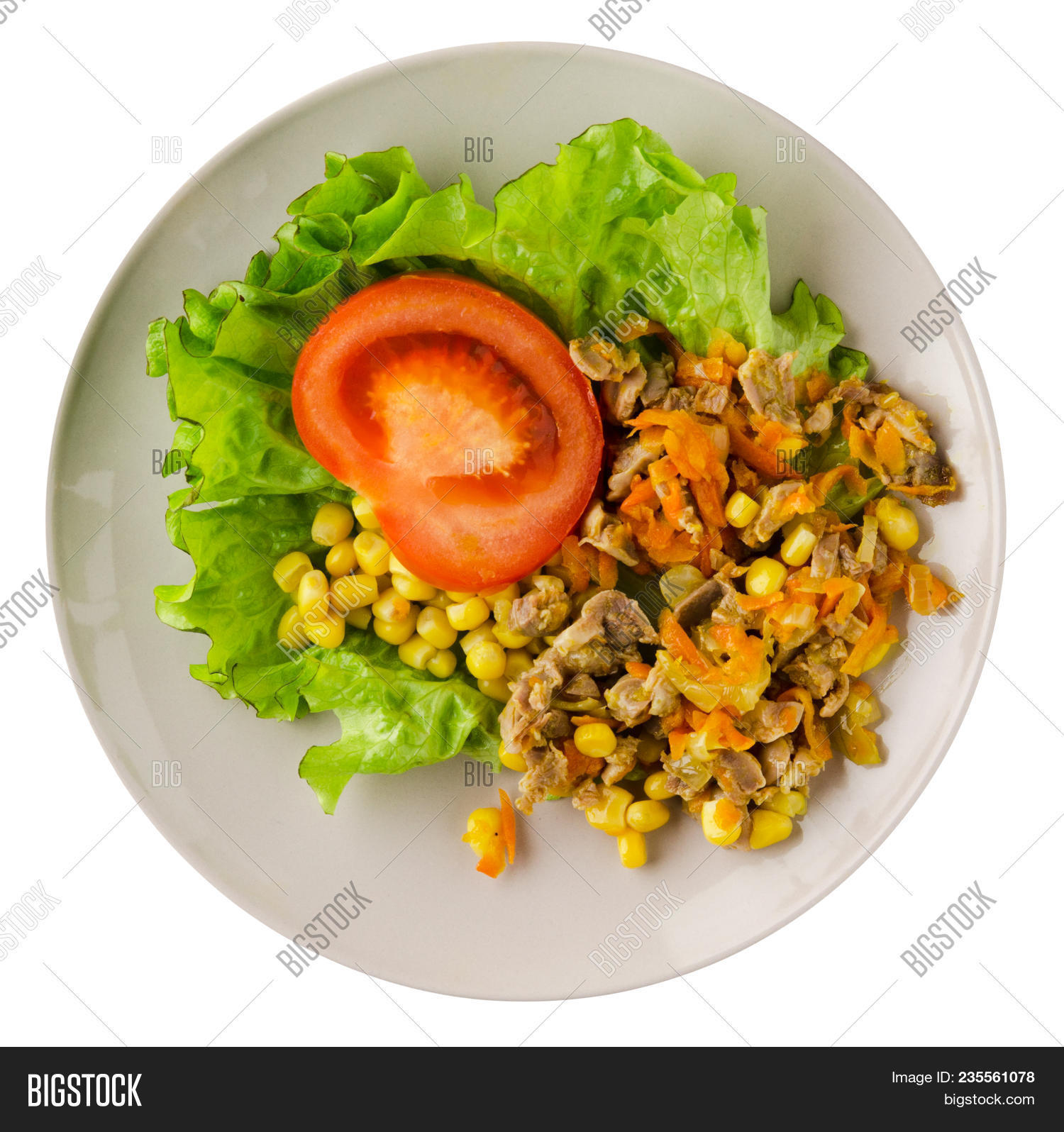 salad with chicken stomachs with carrots and corn and salad on a plate. chicken salad with vegetables isolated on white background