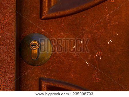 old door lock, aged wooden door, home security, vintage stock photo