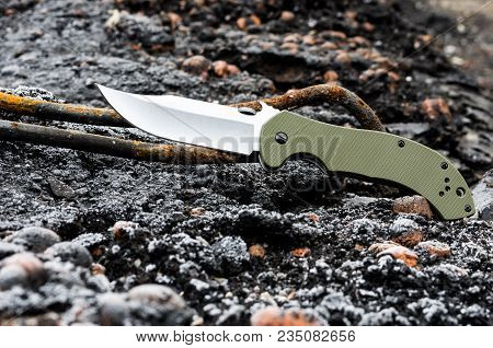 The knife is photographed at an angle. Blade of a knife. A dirty knife. stock photo