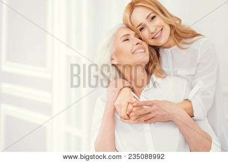 Forever Thankful. Sweet Moment Of Expressing Love Between Retired Mother And Her Loving Daughter Wea