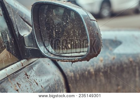 Close-up image of a dirty car after a trip off-road. Side mirror stock photo