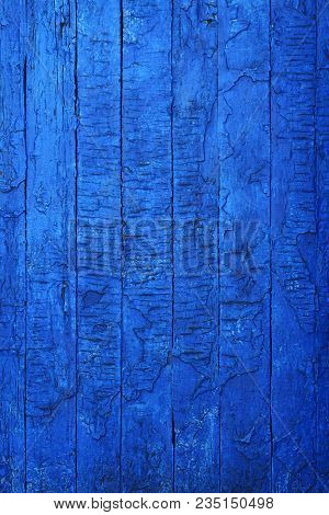 Old grunge rubbed boards repeatedly repainted with blue paint that cracked and peeled off. Natural old shabby wood boards with turquoise faded colors. Horizontal wide screen image with copy space. stock photo