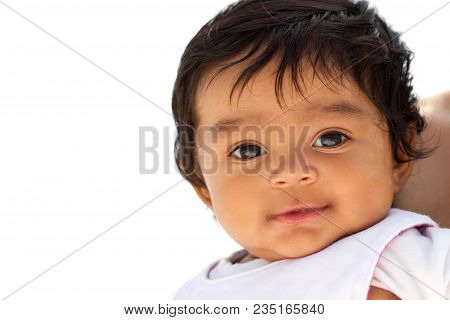 Portrait of a cute little Hispanic baby smiling. stock photo