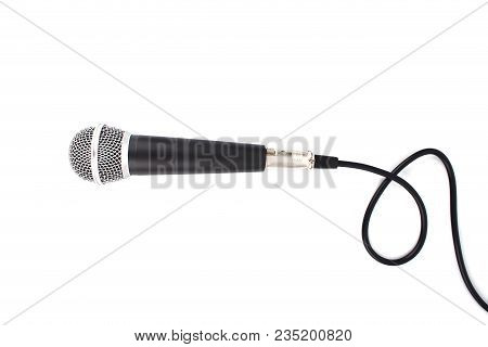 Black Microphone with cable isolated on white background stock photo