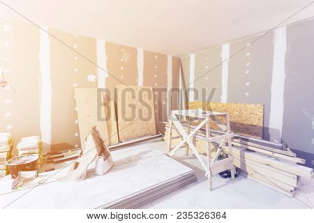 Room Interior And Construction Materials For Construction - Putty Packs, Sheets Of Plasterboard Or D
