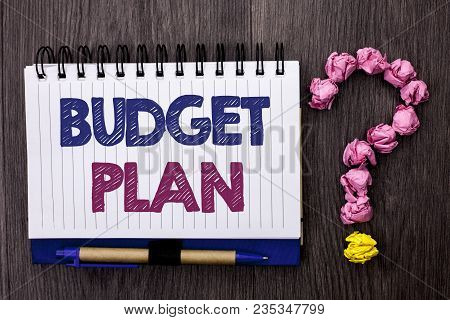 Handwriting text Budget Plan. Concept meaning Accounting Strategy Budgeting Financial Revenue Economics written Notebook Book the wooden background Pen and Question Mark next to it. stock photo
