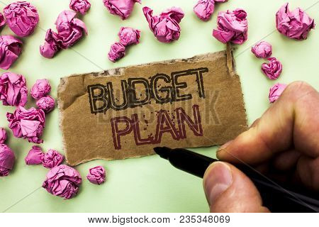 Writing note showing  Budget Plan. Business photo showcasing Accounting Strategy Budgeting Financial Revenue Economics written by Man Holding Marker Tear Cardboard Piece plain background. stock photo