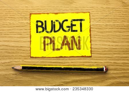 Conceptual hand writing showing Budget Plan. Business photo showcasing Accounting Strategy Budgeting Financial Revenue Economics written Yellow Sticky Note wooden background Pencil. stock photo