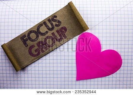 Handwriting text Focus Group. Concept meaning Interactive Concentrating Planning Conference Survey Focused written Cardboard Piece the check background Heart next to it. stock photo