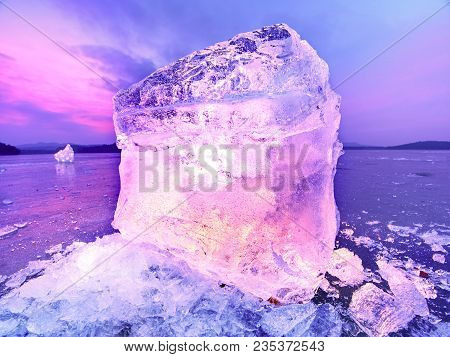 Icebergs and ice floes reflected evening light, Flat icy level in the silent  bay. Drift ice in lagoon stock photo