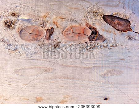 New wooden plank natural knots pattern background. Rotten coarse gray grunge knot on old wooden table or floor. Brown dry grained wooden board wall with knots, cracks and rust marks. Seamless texture stock photo
