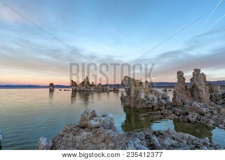 Sunset at Mono lake, California. Bizarre calcareous tufa formation on the smooth water of the lake. stock photo