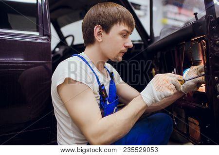 man hands repair left door Car locks auto mechanic stock photo