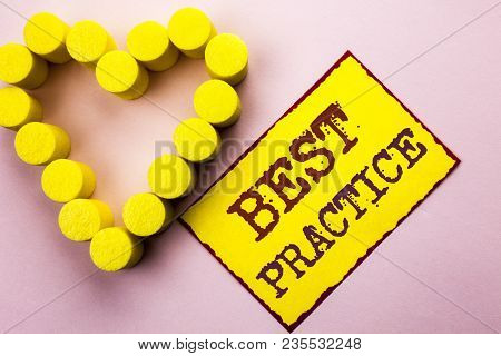 Handwriting text writing Best Practice. Concept meaning Better Strategies Quality Solutions Successful Methods written Yellow Sticky Note Paper Plain background with Heart next to it. stock photo