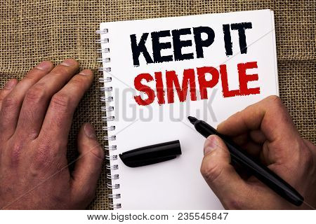 Handwriting text writing Keep It Simple. Concept meaning Simplify Things Easy Understandable Clear Concise Ideas written by Man Holding Marker Notebook Book the jute background. stock photo
