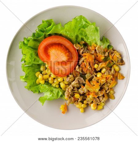 salad with chicken stomachs with carrots and corn and salad on a plate. chicken salad with vegetables isolated on white background stock photo