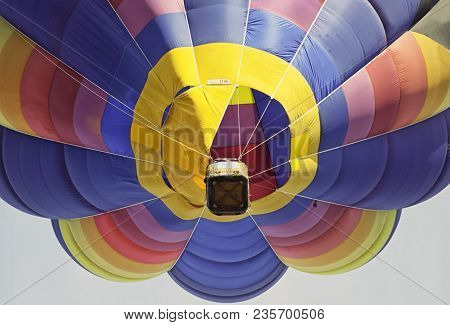 Close-up view from a low angle of a colorful hot-air balloon flying in the Italian sky above Udine. Concept for freedom and adventure stock photo