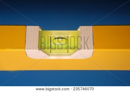 a tool for mesuaring the level on blue background stock photo