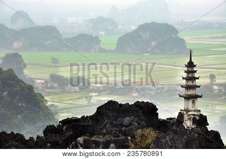 Panorama view of rice fields and limestone rocks from Hang Mua Temple viewpoint in a rainy day. Tam Coc, Ninh Binh, Vietnam stock photo