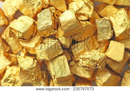 Golden Background. Ingots or Nuggets of Pure Gold. Gold leaf. Tea Resin Puer. stock photo