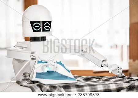 music robot is playing a record while touching with his finger the record. Cocept music streaming or downloading, futuristic music player stock photo