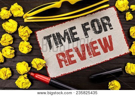 Conceptual hand writing showing Time For Review. Business photo text Evaluation Feedback Moment Performance Rate Assess written Cardboard Piece the wooden background Marker Glasses. stock photo