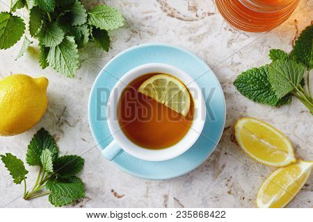 Lemon balm tea with honey. Cup of hot honey lemon balm tea. Lemon balm is a herb that belongs to the mint family and is known for its medicinal benefits.  stock photo