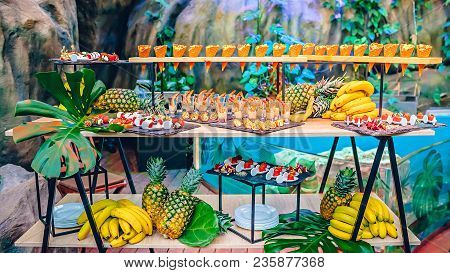 Sea food buffet with desserts at a party decorated in tropical style stock photo