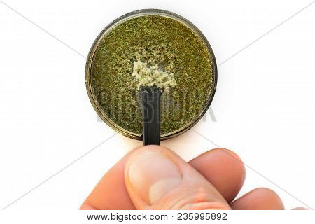 Kief in grinder for weed macro Trichomes buds of Cannabis And stock photo