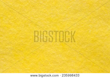 viscose napkin household for dry and wet cleaning, yellow color, close-up. Background, texture stock photo