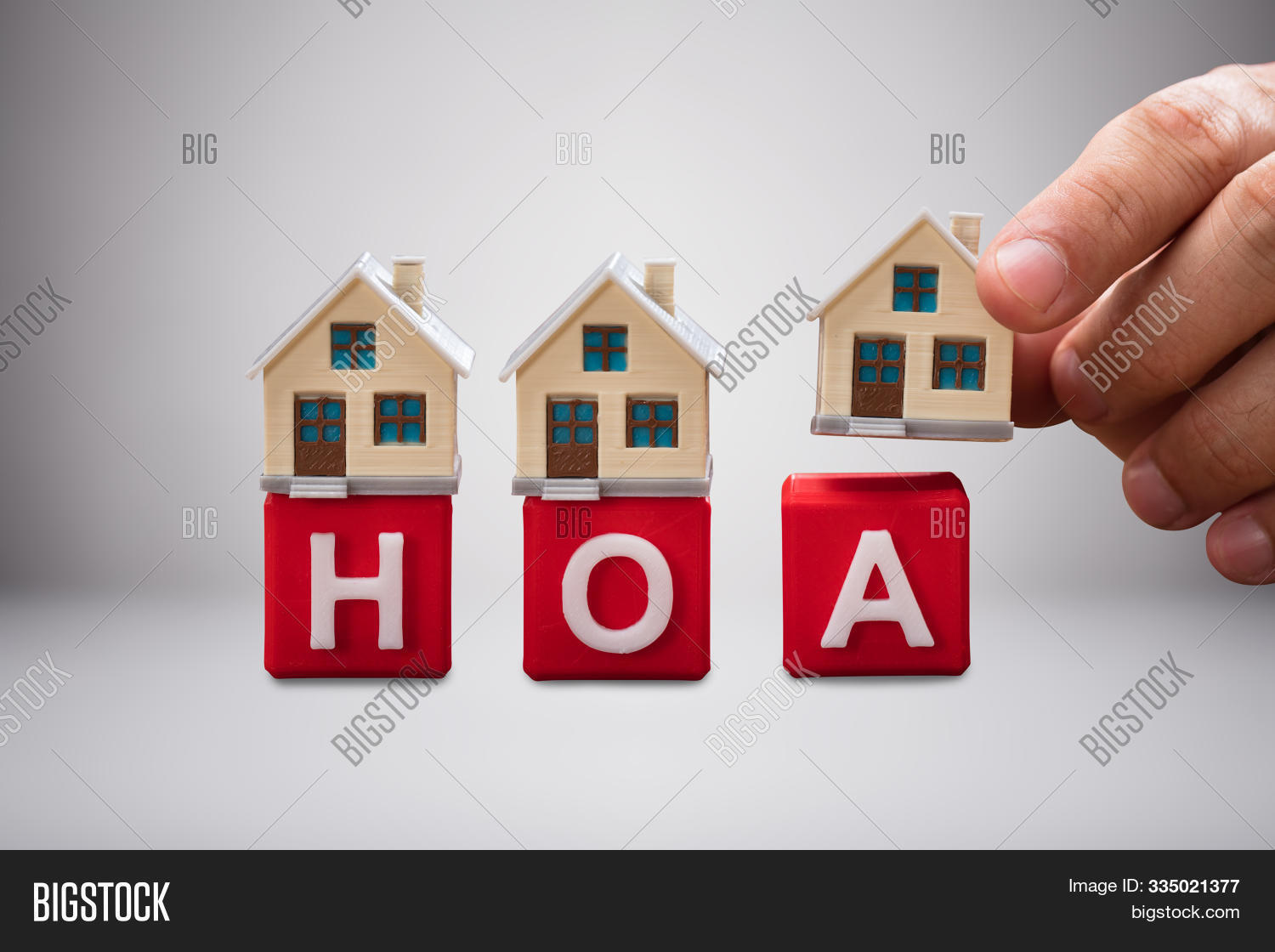 adult,alphabet,arrange,association,backdrop,background,block,buy,capital,closeup,community,concept,conceptual,cube,desk,estate,finger,hand,hoa,hold,holding,home,homeowner,house,human,indoors,inside,letter,model,object,owner,people,person,placing,property,purchase,real,residential,row,sale,skin,studio,take,taking,white