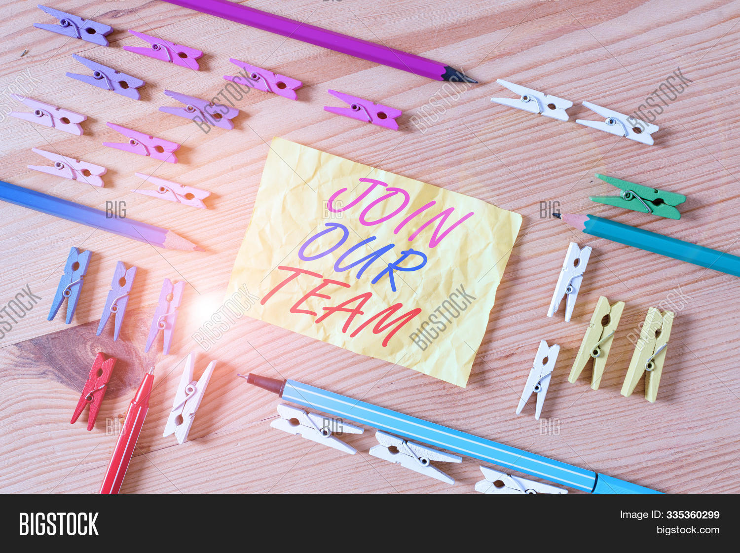 Text sign showing Join Our Team. Conceptual photo Allied Associate Work with us New Employee Hired Enlist Colored clothespin papers empty reminder wooden floor background office.