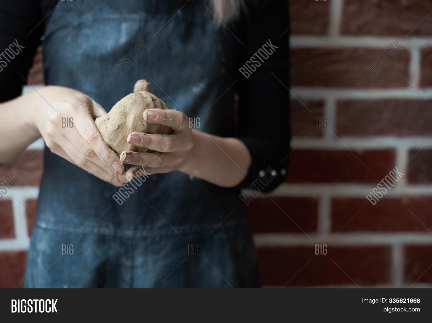 Unrecognisable woman making ceramic bowl in hand. Creative hobby concept. Earn extra money, side hustle, turning hobbies into cash, passion into job, copy empty space