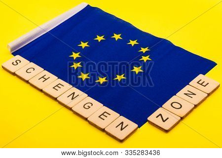 European union concept showing the flag of the EU on a yellow background with a sign reading Schengen Zone stock photo