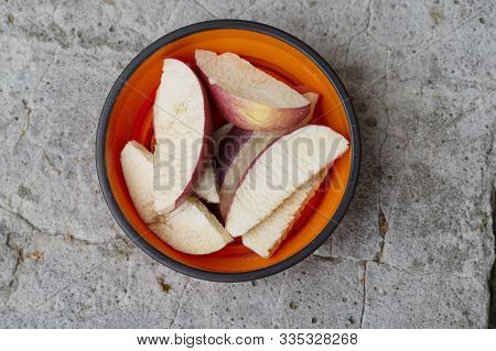 Apple with cinnamon. Sliced apple with cinnamon. Apple slices in a plate. Top. stock photo